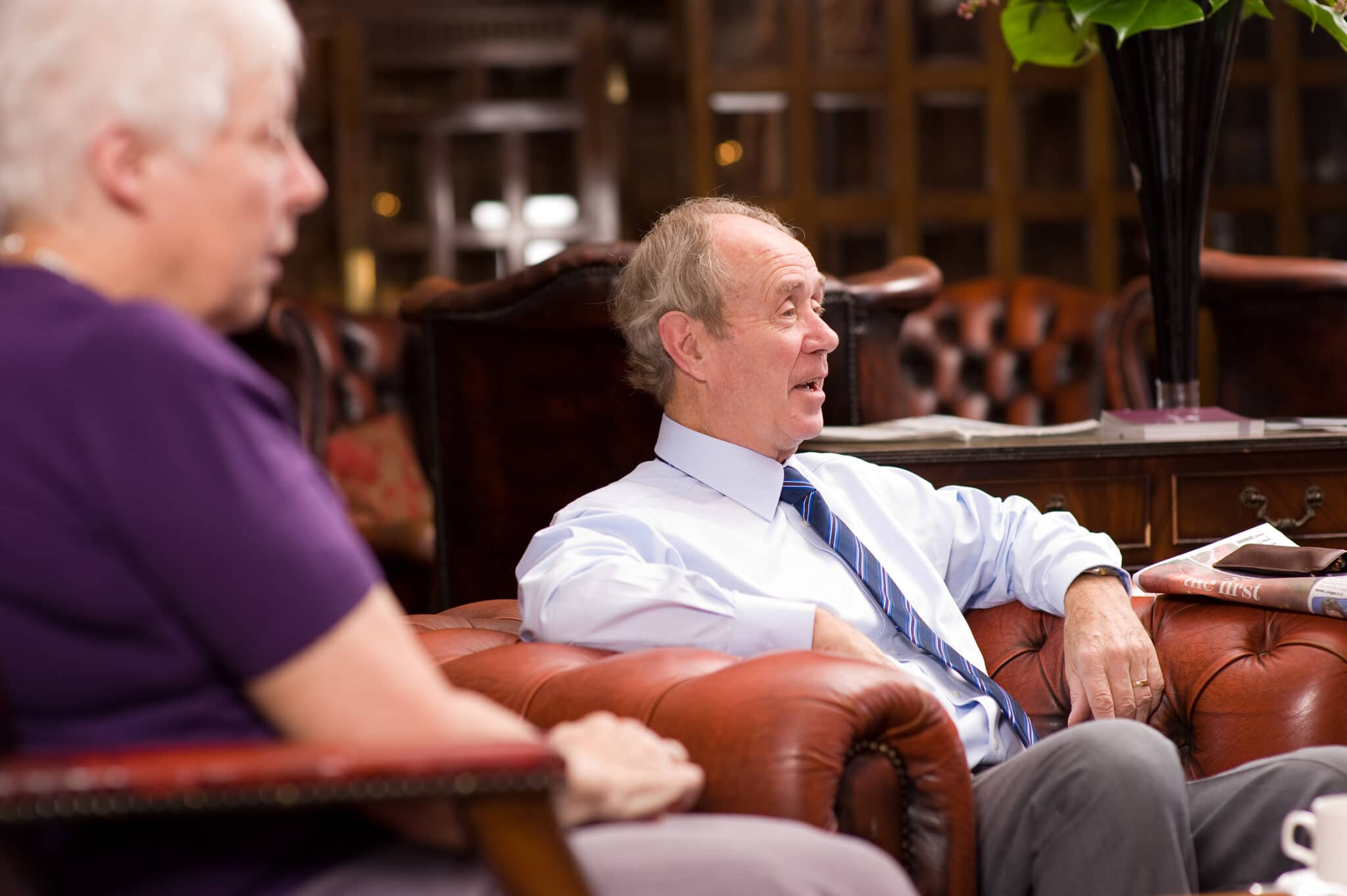 Happy older man lounging in an armchair