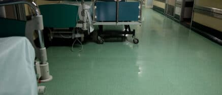 trolleys in a corridor of an overcrowded hospital