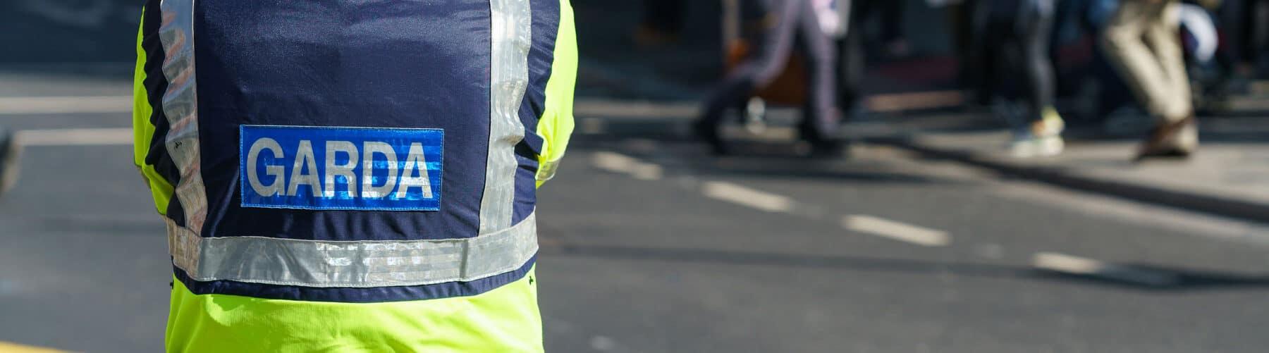 Garda standing on the street looking diligent