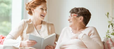 carer and patient sharing a laugh together